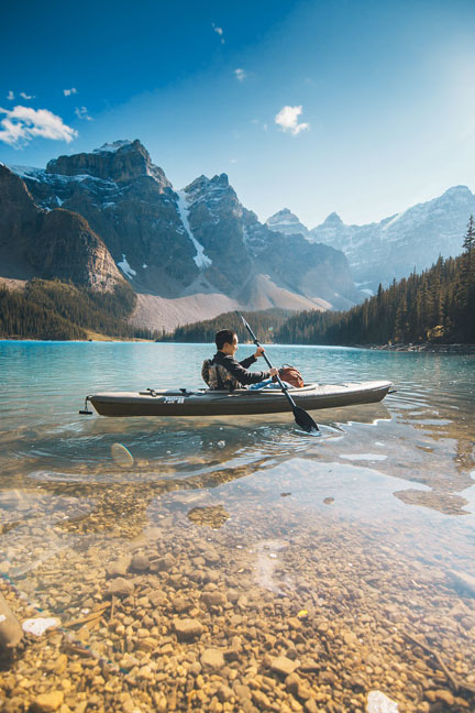 Man in kayak with mountains in background