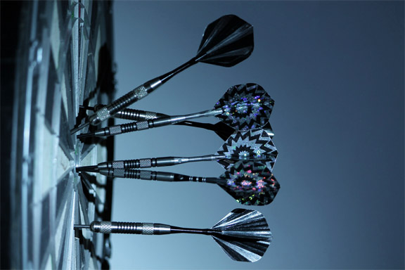 Four darts on a target